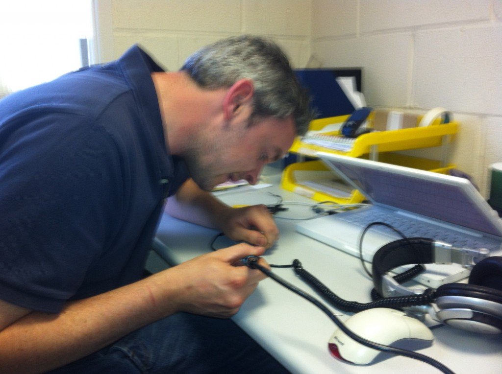 Eoin soldering the Sony MDR v700 headphone wires together